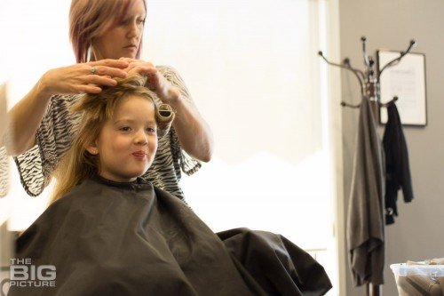 children's portraits photography, girl getting her hair done at a salon for the first time
