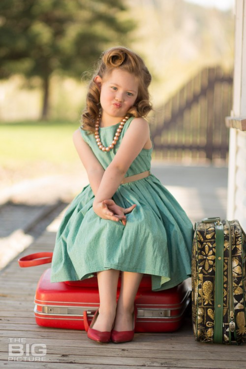 children's portraits, children's photography, vintage recreation photos, little girl with luggage waiting at train station, victory rolls