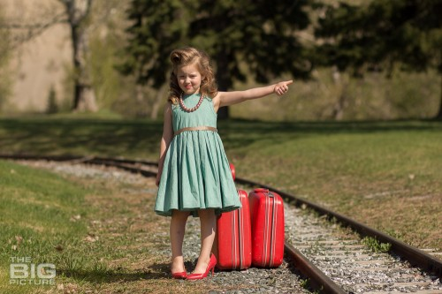 children's photography, young girl in high heels and victory rolls hitchhiking at railroad tracks, children's pictures railroad tracks, runaway