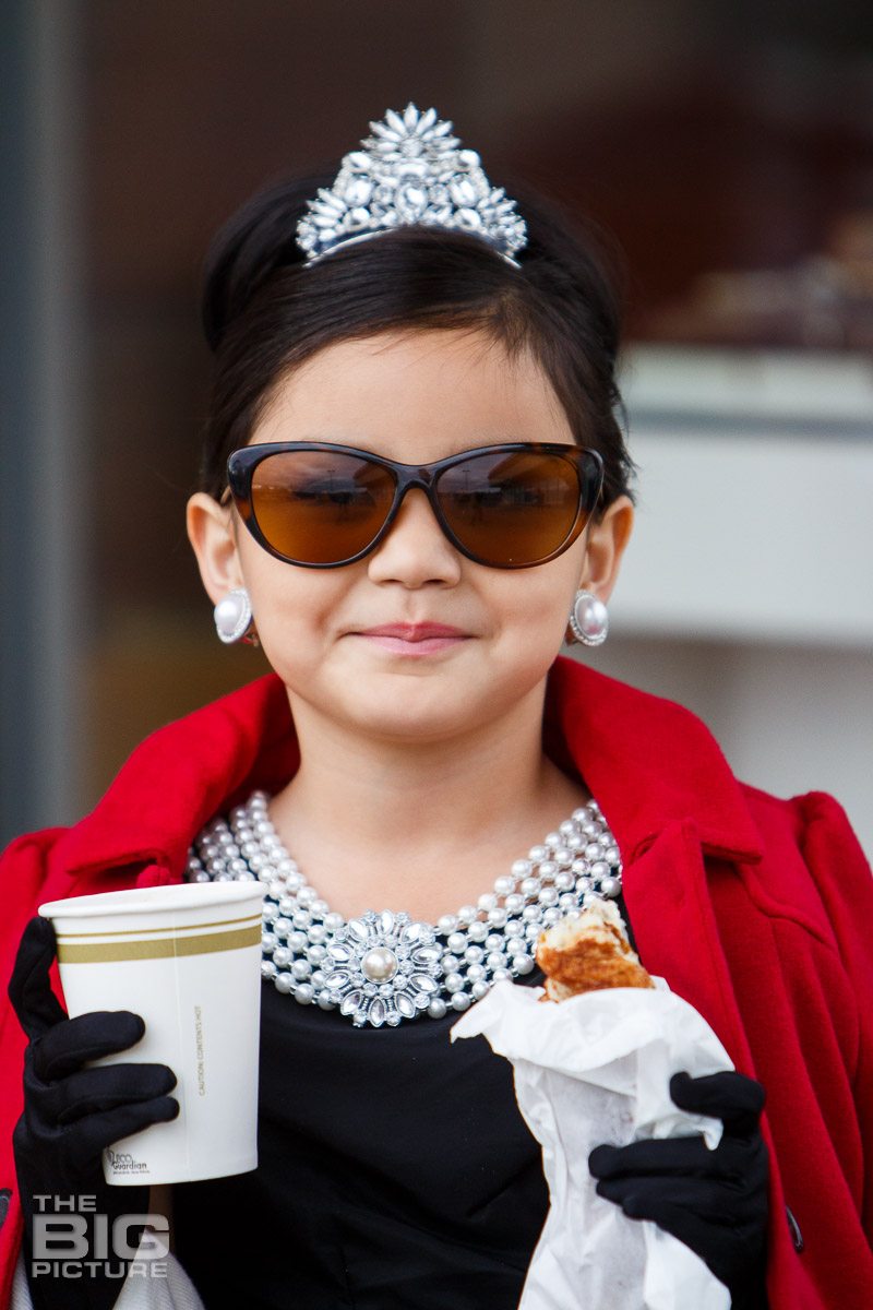 Ava wearing a tiara and holding coffee and a doughnut - kids photography - children's photography