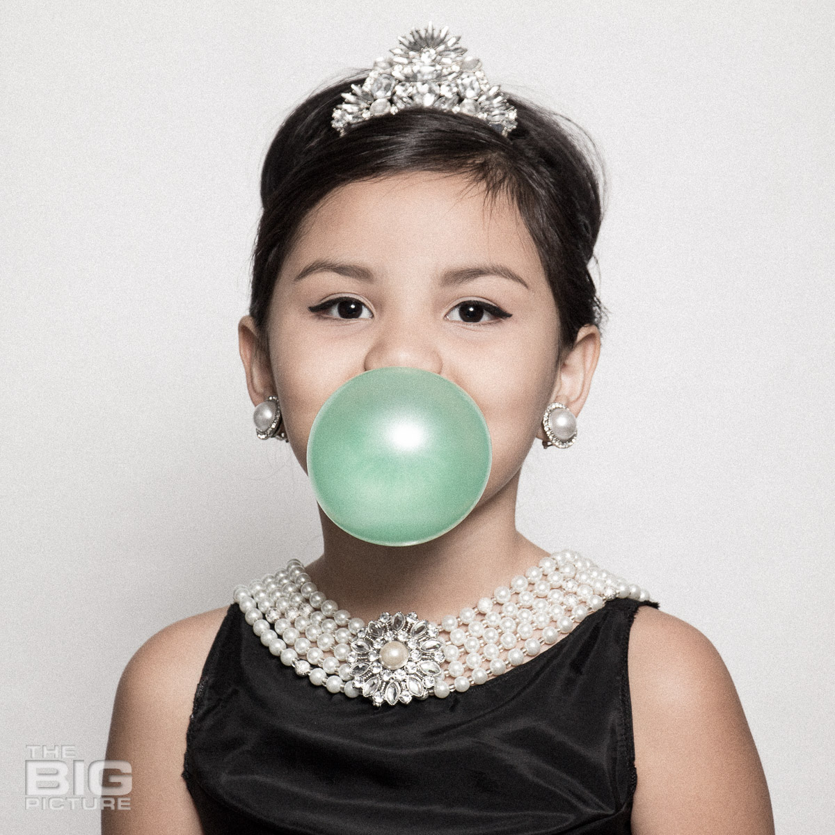 Ava blowing a bubble like Audrey Hepburn in a scene from breakfast at Tiffany's  - kids photography - children's photography
