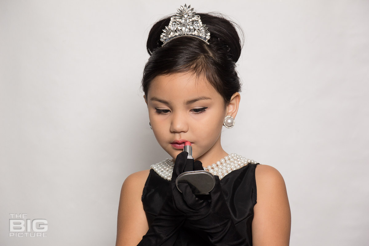 Ava putting on makup like Audrey Hepburn in a scene from breakfast at Tiffany's  - kids photography - children's photography