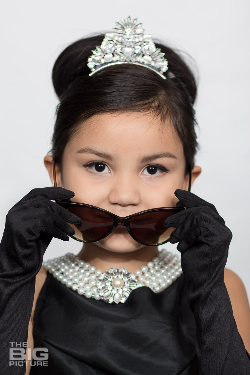Ava dressed up like Audrey Hepburn in a scene from breakfast at Tiffany's  - kids photography - children's photography