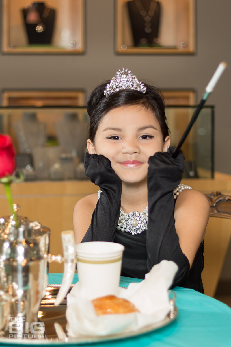Ava - young girl with a tiara on sitting in a jewellery shop - kids photography - children's photography