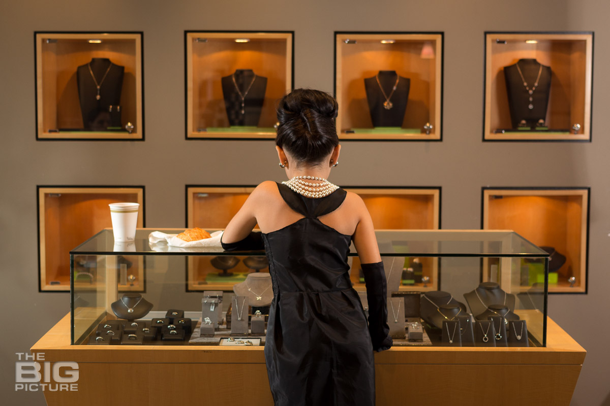 Ava standing at the jewellery shop looking at necklaces - children's photography - kids photography
