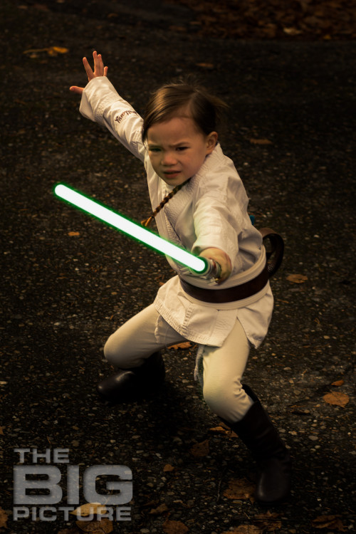 female Jedi with drawn lightsaber, children's cosplay - Children's Photography