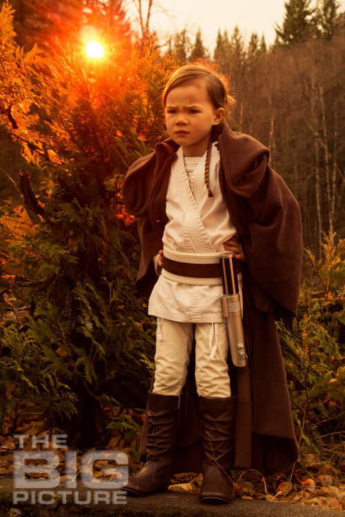 Jade the Jedi, girl padawan standing on Endor with lightsaber and a pensive look on her face, female Jedi, kids cosplay - Children's Photography