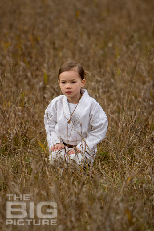 Jade the Jedi, girl padawan kneeling in a grassy field, female Jedi - Children's Photography